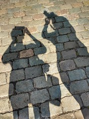 Two Flickr ladies on the road (wilma HW61) Tags: schaduw shadow ombra schatten ombre figuren figure figures abbildung cifra nederland niederlande netherlands holland holanda paísesbajos paesibassi paysbas europa europe été zomer summer sommer zonlicht licht light outdoor wilmahw61 wilmawesterhoud motorolamotog3 smartphone straat street keien stoneboulders stenen straatstenen streetstones selciato pavés pflastersteine