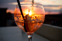 Aperol spritz cocktail in sunset (wuestenigel) Tags: glass color sunset water alcoholic table background orange soda food alcohol spritz fresh bar liqueur citrus cocktails against wooden restaurant party italy aperitif aperol cold drink frozen ice italian cocktail closeup beverage red summer fruit drinks refreshment