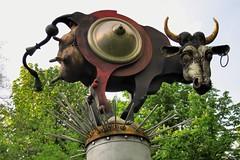 Modernist-fantastic public art, 'Cow-riosity', Juergen Goertz, 1989 - Schlosspark Eichtersheim, Angelbachtal, Baden-Württemberg, Germany (edk7) Tags: olympuspenliteepl5 edk7 2015 germany deutschland badenwürttemberg rheinneckarkreis angelbachtal schlossparkeichtersheim modernistfantasticpublicartcowriosityjuergengoertz1989 metallic sculpture installation botanicalgarden artwork jürgengörtz cow shield horn udder