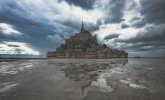 Le Mont Saint Michel (Eddy Alvarez) Tags: france europe mont saint michel castle church hill seascape ocean dramatic sky travel destination clouds outdoor reflection