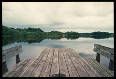 Ett bord med bänkar vid sjön (F²/400) (mmartinsson) Tags: lomography f²400 reflection ts sweden lake 35mm film tjörnarpssjön f2 2017 expired ferrania scan nikonf3 epsonperfectionv700 walimex analoguephotography tiltshift walimex24mm skånelän sverige se