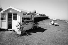 Surf shop breton (Film_Fresh_Start) Tags: 24x36 argentique borddemer ilfordfp4125 pentaxlx pentaxsmckseries30mm28 plounéourtrez slr vacances film bw nb