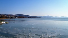A frozen shore (Francesco Pesciarelli) Tags: lake trasimeno umbria italy italia frozen shore sky water ice hills flickr pesha colors life big downloadable mentionmyname varied collection thoughtful colours