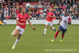 Mark Shelton heads the ball out-6945