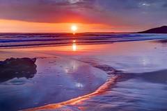 Spiralling (pauldunn52) Tags: rock pool sunset southerndown red purple sand reflection glamorgan heritage coast wales