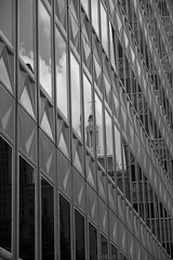 Reverberation (Brinkervelt.) Tags: building structure architecture geometric geometry bw blackandwhite blackwhite cmwd cmwdblackandwhite noiretblanc downtown urban clouds reflection distortion windows glass cupola