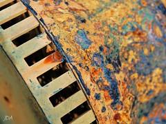 Macro Monday ~ Rust (Jan Whybourne) Tags: macromonday rust patina orange blue texture rectangle chips