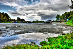After the storm (Geoff Henson) Tags: puddle rain storm shower ashdownforest sussex cars road grass nikon sigma clouds