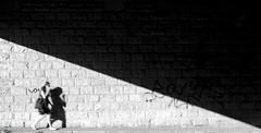 Call (CoolMcFlash) Tags: phone call person candid woman street streetphotography contrast bnw blackandwhite blackwhite vienna canon eos 60d shadow wall anruf telefon handy frau strase kontrast sw bw schwarzweis wien schatten wand city stadt citylife motion movement walk gehen motionblur bewegung bewegungsunschärfe fotografie photography tamron b008 18270