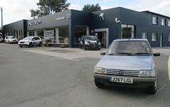 Blue 205 at the dealer who sold it new. (occama) Tags: j267lgl peugeot 205 1992 14 gr blue cornwall hawkins dealer garage ststephen