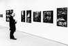 Updating The Followers (Sean Batten) Tags: london england unitedkingdom gb blackandwhite bw candid people person artgallery saatchigallery city urban nikon d800 58mm art pictures wall