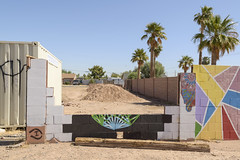East Oak Street (GC_Dean) Tags: phoenix arizona blockwall broken brokenfence brokenwall container mural handpaintedwall graffiti sky clearsky bluesky trees palmtrees palm shape shapes dirt dirtpile lumber wood timber wires street emptiness mundane city cityscape urban urbanlandscape sociallandscape space colors color colours structure building shadows flora