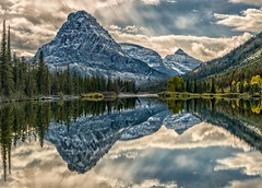 Sun Over Sinopah (Philip Kuntz) Tags: sun mtsinopah praylake midday daylight reflections autumn twomedicine glacier glaciernationalpark montana
