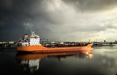 Port Amsterdam Orange ship (DieLei) Tags: haven harbour 6s iphone schip vrachtschip ship landschap europe europ holland water landscape dark donker wolken licht cloudporn clouds sky port portofamsterdam amsterdam
