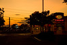 09-3833 (George Hamlin) Tags: virginia chantilly sunset autos cars street road colorful fast food gasoline station exxon kentucky fried chicken signs light shadow dark wires poles clouds sky photo decor george hamlin photography aw