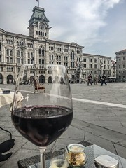 A glas of red in Trieste