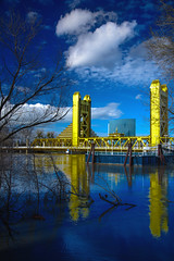 Blue and Yellow Reflections (Janet Kopper Photography) Tags: sacramento sacramentoriver oldsacramento towerbridge clouds blue yellow bridges california