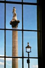 streetlight (khrawlings) Tags: trafalgar square window national gallery london streetlight column nelson plinth lines pane glass