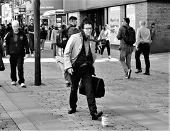 Windswept Man (LozHudson) Tags: manchester street streetphotography fuji fujifilm fujix100s x100s blackandwhite blackwhite monochrome streetperformer windsweptman