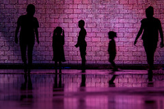 shadows ... (mariola aga) Tags: chicago millenniumpark evening night kids silhouettes shadows water reflection wall purple light crownfountain art