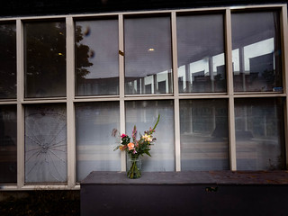 Broken window and a lonely bouquet