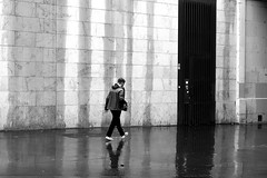 In front of the mysterious door (pascalcolin1) Tags: paris13 homme man door porte pluie rain reflets reflection photoderue streetview urbanarte noiretblanc blackandwhite photopascalcolin