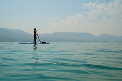 Paddleboarding on Bear Lake [Explore] (aaronrhawkins) Tags: paddleboard bearlake water lake swim swimming silhouette woman figure kellie girl mountain calm sport watersport utah idaho northshore recreation vacation blue turquoise aquamarine aaronhawkins paddle float
