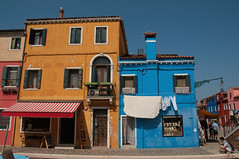 Burano 45 (ValterB) Tags: euro2017 nikond90 2017 venice burano italy italia venezia venedig lagoon scenic sky blue travel magical tourism summer beautiful scenery extreme tourist lonely sun hot solitude natural view peak heat colors colour street streetphotography building architecture facadelines shadow abstract tiles shapes geometrical urbanphotography urban photography paintedstreetwalls orange red stripes lamp window door valterb