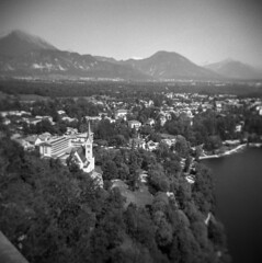 View from Blejski Grad above Lake Bled (Blurmageddon) Tags: mediumformat film analogphotography 6x6 holga120gcfn tmy400 tmax400 kodak rodinal semistand standdeveloped blackandwhite europe travel vacation epsonv700 toycamera plasticfantastic lakebled slovenia