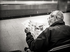 a.dying.breed (grizzleur) Tags: street streetphotography candid candidphotography news newspaper airport reading man relax relaxed bw mono monochrome pov olympus olympusomdem5mkii leicadgsummilux25f14 omd omdstreetphotography