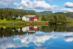 The farm at the lake (CecilieSonstebyPhotography) Tags: norway september autumn building clouds fall farm grass green house høst lake red reflection reflections sky trees water white