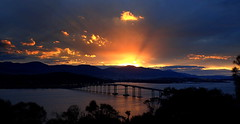 ALL LIT UP at SUNSET (Lani Elliott) Tags: scene scenic view landscape river water riverderwent derwentriver hobart silhouette silhouettes scenictasmania sunset sky lightrays colour color colourful blue cold chilly bridge tasmanbridge awesome wow gorgeous excellent beautiful