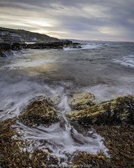 The other side of the harbour wall... (Stephen_Lavery) Tags: countyantrim islandmagee northernireland portmuck stephenlavery coast coastal dusk rock sea shore shoreline sunset surf wash water waves henri cartierbresson