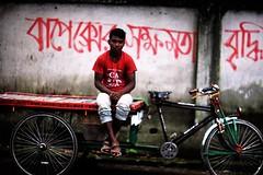 I like RED too you know ! (N A Y E E M) Tags: youngman rickshawvan red graffiti street candid sarsonroad chittagong bangladesh carwindow