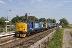 37419 trails through Buckenham station working 2J80 1455 Norwich - Lowestoft 19/7/2017 (Paul-Green) Tags: class 37 374 37419 37405 aga abellio greater anglia passenger service drs direct rail services flickr canon camera july 2017 outdoors sun sunny afternoon station transport railways tracks fields 1455 norwich lowestoft buckenham 2j80