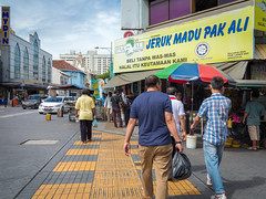 Walking along Penang Road (Stratman² - (Joey and I are both ill )) Tags: canonphotography powershotg1x people streetphotography citypulse penang georgetown jerukmadupakali
