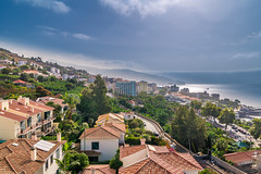 Morning on Madeira (Wolfhowl) Tags: view funchal landscape naturallight cuityscape nature water mountains buildings roofs madeira atlantic city rocks clear trees blue beach ocean hills travel dawn morning island sky green португалія europe 2017 portugal