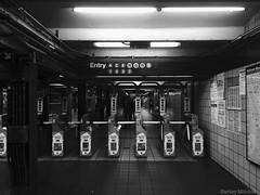 Enter the Subway (Harley Mitchell) Tags: subway newyorkcity nyc dark blackandwhite