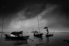Before the storm! (ashik mahmud 1847) Tags: blackandwhite bangladesh nikkor d5100 river water boat storm cloud people man umbrella ngc