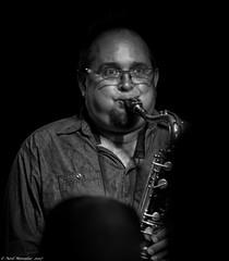 Black and Blues 1 (Neil. Moralee) Tags: neilmoralee usa2017neilmoralee saxaphone sax jaz blues music cafe city man player musician black white mono monochrome blow hard glasses face portrait live neil moralee nikon d7200 high iso beale street candid memphis tennessee usa brass woodwind sound dark darkness club joint balding shirt blackandwhite bw bandw