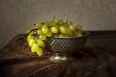 Still Life with Grapes (suzanne~) Tags: stilllife tabletop grape fruit bowl silverbowl ikat orientaltextile indoor lensbaby textured softfocusoptic