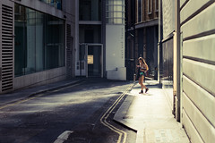 Sunshine Texting (Sean Batten) Tags: london england unitedkingdom gb streetphotography street candid nikon df 58mm person alley oxfordst city urban texting mobilephone sunshine light road pavement