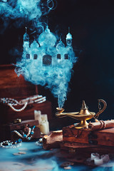 Magic lamp with mystic smoke forming an arabic castle, still life with treasure and jewelry. (Dina Belenko) Tags: aladdin alchemy antique arabian arabic art assistance concept dark desire dreams enchanted ethereal fairytale fantasy flying genie glowing gold golden help idea imagination inspiration lamp lantern levitation literature luck magic magical metaphor mystery mystical mythology nights oldfashioned persian prosperity religion smoke spell spirituality stilllife study success wealth wisdom