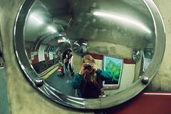 Underground Mirror (_anke_) Tags: film meinfilmlab analog wwwmeinfilmlabde london england uk greatbritain britain filmphotography 35mm kleinbild canonae1 fd50mm18 canonfdlens grain grainy scan analogue mirror reflection fisheye self portrait selfie