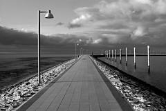 Juist (Arnolt S.) Tags: juist ostfriesischeinseln nordsee northsea germany sky clouds wolken lamps bw blackandwhite schwarzweiss monochrome nikon nikond60 perspective water lines