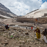 Pilgrims crossing the snow fields - Amarnath Yatra, 2. day from Sheshnag to the camp-town of Amarnath cave, Kashmir, India thumbnail