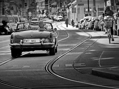 summer in the city (heinzkren) Tags: mg cabrio car auto pkw panasonic lumix street streetphotography schwarzweis biancoetnero blackandwhite monochrome urban wien vienna linien gleis geleise strasenbahn oldtimer kurve curves line traffic verkehr