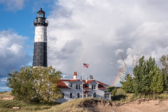 Big Sable Afterglow (Aaron Springer) Tags: michigan northernmichigan bigsablepointlight lighthouse rainbow flagpole sand dune beach clouds sunlit september outdoor landscape