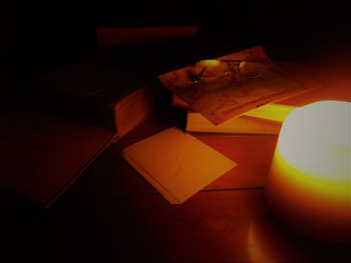 Mysterious Books and a map by Candle Light