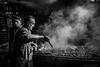 Mastro di fuoco (dasalpi_photo) Tags: taormina sicilia monocromo persone streephotography bbq barbecue grigliata carne cibo